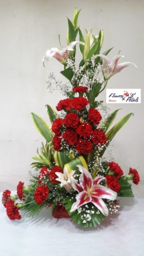 Lilies with carnations in flower arrangement