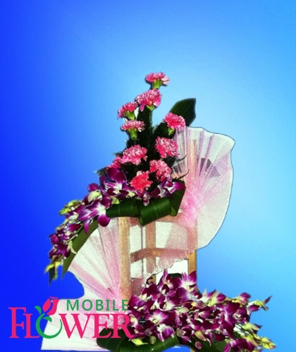 orchid n carnation arrangement / mobile flower pune