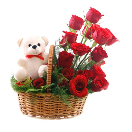 Ravishing Arrangement of Fresh Red Roses with a Small Teddy