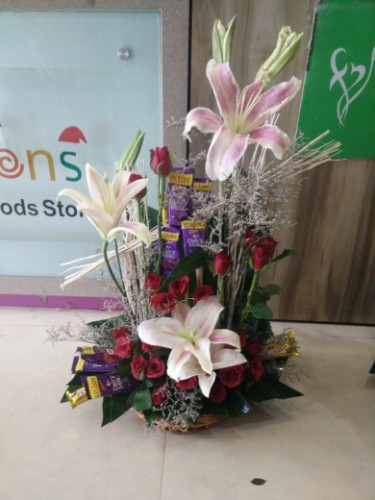 Lilies with roses and chocolates