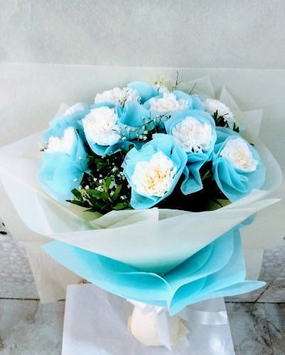 12 White Carnation in Blue Paper Packing