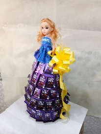 Ravishing Arrangement of Cadbury Doll