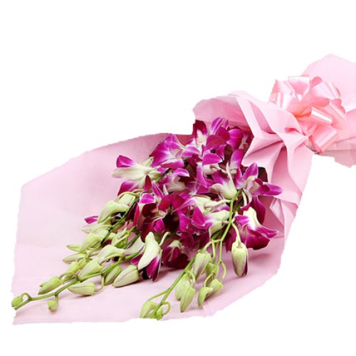 6 Purple orchids in pink paper bunch